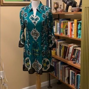 Dress with bell sleeves, turquoise pattern.